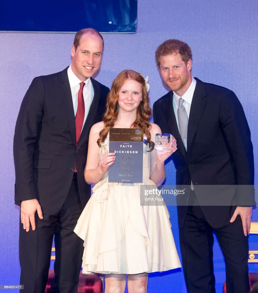 Prince William, Duke of Cambridge and Prince Harry present an award to Faith Dickinson from Ontario at the Diana Award's at St James' Palace on May 18, 2017 in London, England.