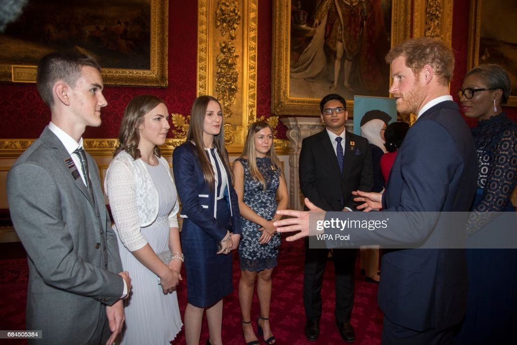 Prince William, Duke of Cambridge (not pictured) and Prince Harry speak to some of the winners at the Diana Award's at St James' Palace on May 18, 2017 in London, England.