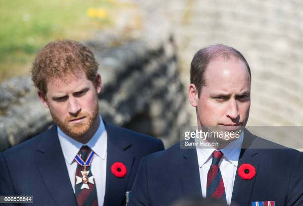 Prince William Duke of Cambridge and Prince Harry walk through a trench during the commemorations for the 100th anniversary of the battle of Vimy...