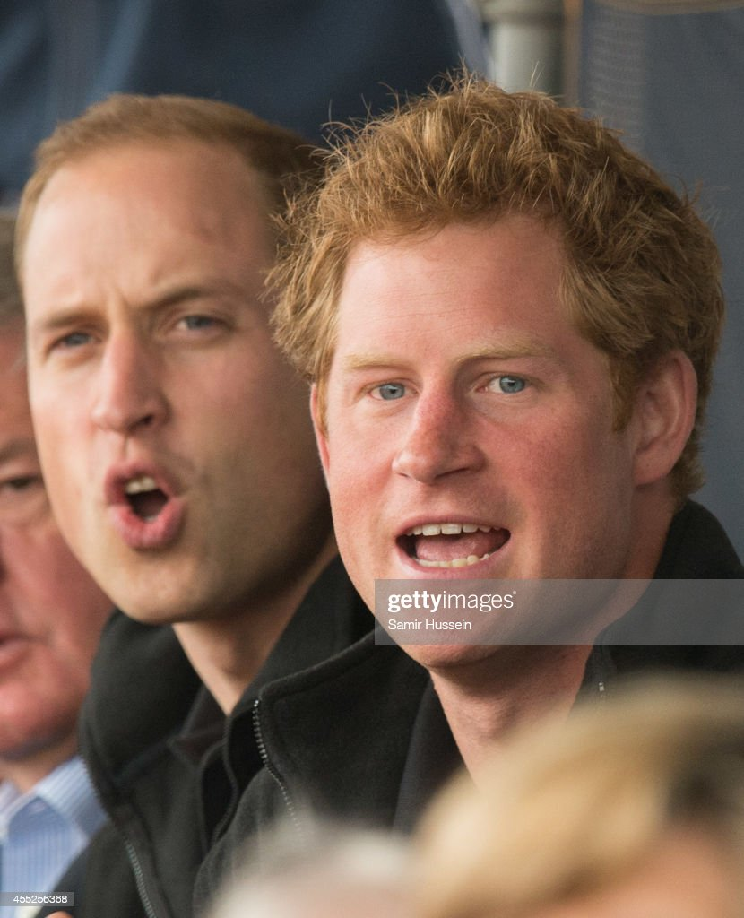 Prince William, Duke of Cambridge and Prince Harry watch the athletics at Lee Valley Track during the Invictus Games on September 11, 2014 in London, England.