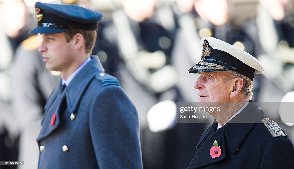 Prince William, Duke of Cambridge and Prince Philip, Duke of Edinburgh attend Remembrance Sunday at the Cenotaph on Whitehall on November 10, 2013 in London, England.