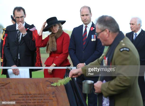 Prince William Duke of Cambridge and Princess Astrid of Belgium watch as a commemorative plaque they unveiled is blessed as they attend the New...
