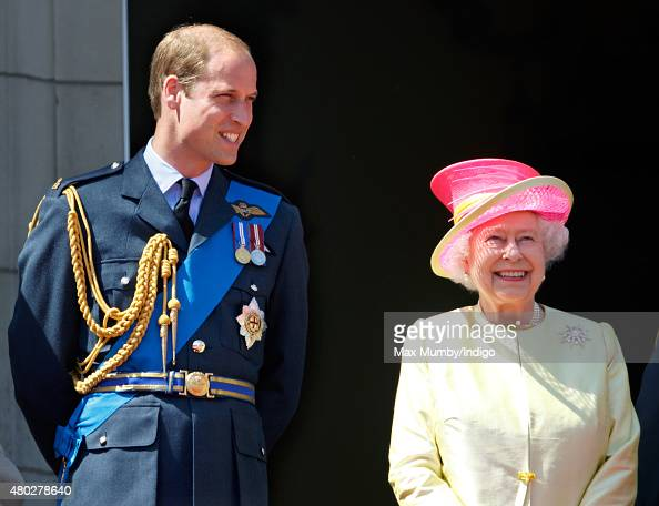 Prince William Duke of Cambridge and Queen Elizabeth II watch a flypast of Spitfire Hurricane aircraft from the balcony of Buckingham Palace to...