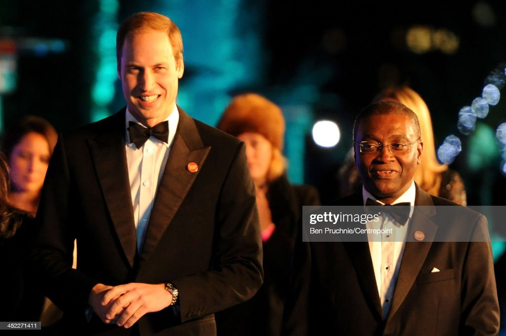 Prince William, Duke of Cambridge (L) and Seyi Obakin, Centrepoint Chief Executive , Chief Executive of Centrepoint attend the Winter Whites Gala In Aid Of Centrepoint on November 26, 2013 in London, England.