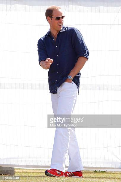 Prince William Duke of Cambridge arrives to play in the Audi Polo Challenge at Coworth Park Polo Club on August 3 2013 in Ascot England