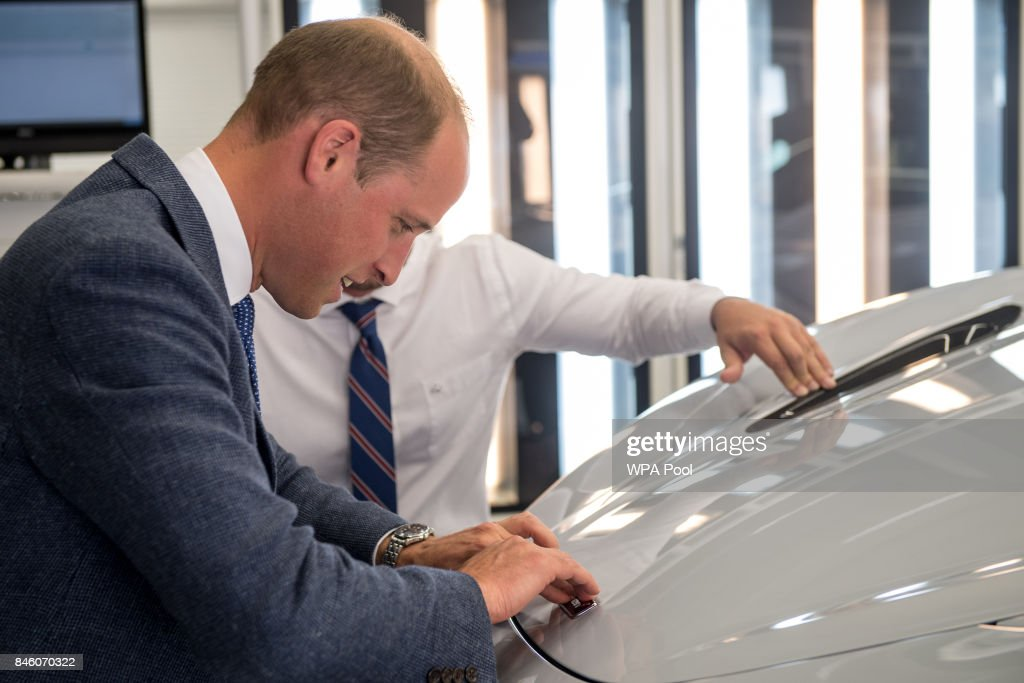 Prince William, Duke of Cambridge attaches a McLaren badge to the front of a new and finished McLaren 720S on the factory floor during a visit to McLaren Automotive at McLaren Technology Centre on September 12, 2017 in Woking, England.