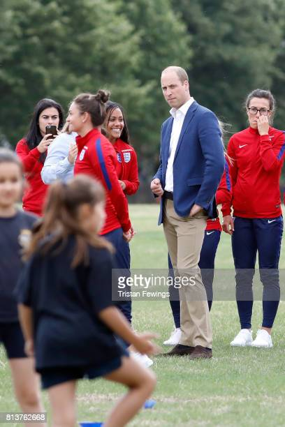 Prince William Duke of Cambridge attends a kickabout with the Lionesses and local girls team from the Wildcats Girl' Football programme on July 13...