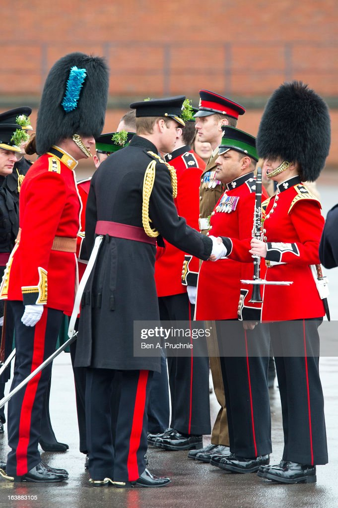 Prince William, Duke of Cambridge attends a St Patrick's Day parade by the 1st Battalion Irish Guards as he visits Aldershot Barracks on St Patrick's Day on March 17, 2013 in Aldershot, England.