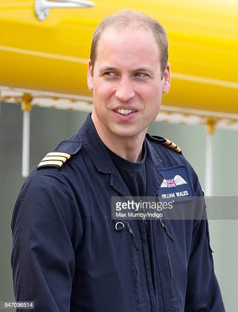 Prince William Duke of Cambridge attends the opening by Queen Elizabeth II of the East Anglian Air Ambulance base at Cambridge Airport on July 13...