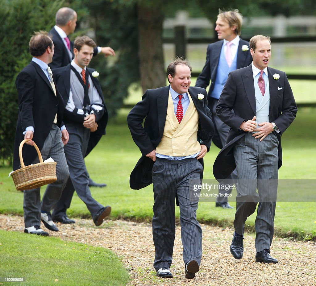 Prince William, Duke of Cambridge (r) attends the wedding of James Meade and Lady Laura Marsham at the Parish Church of St. Nicholas in Gayton on September 14, 2013 near King's Lynn, England.