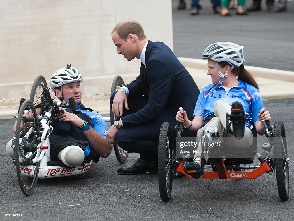 Prince William. Duke of Cambridge bends to talk to competitors in the the Hero Ride charity race as he visits Help For Heroes Recovery Centre on May 20, 2013 in Tidworth, England.
