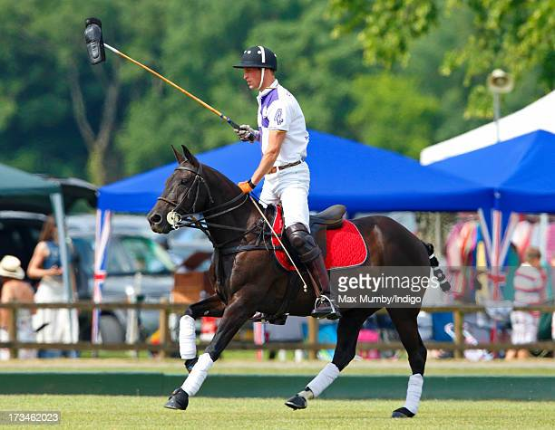 Prince William Duke of Cambridge carries a horses boot on the end of his polo mallet as he plays in the Jerudong Trophy polo match at Cirencester...