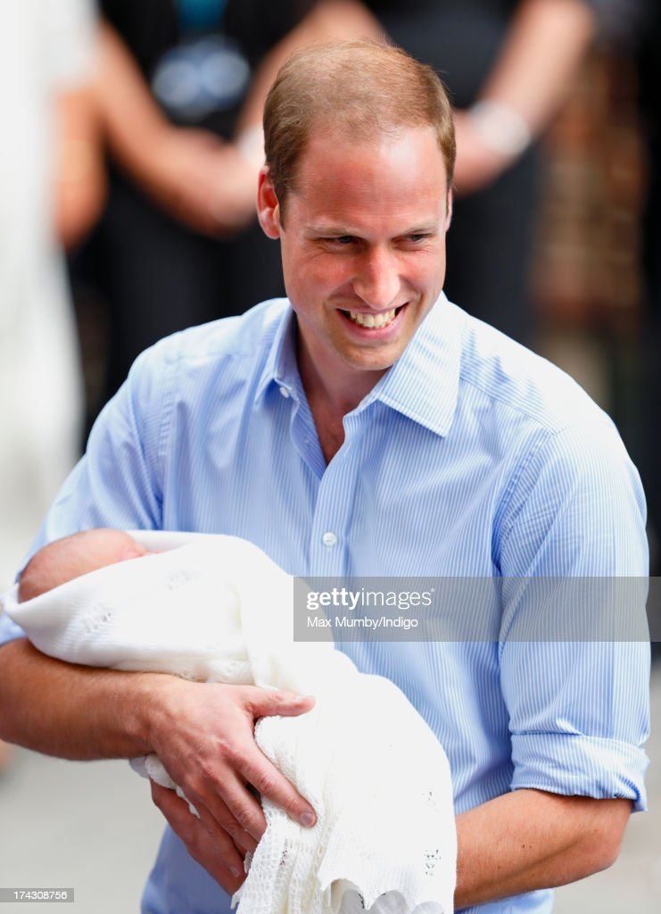 Prince William, Duke of Cambridge carries his newborn son as he and Catherine, Duchess of Cambridge leave The Lindo Wing at St Mary's Hospital on July 23, 2013 in London, England. The Duchess of Cambridge yesterday gave birth to a boy at 16.24 BST and weighing 8lb 6oz, with Prince William at her side. The baby, as yet unnamed, is third in line to the throne and becomes the Prince of Cambridge.