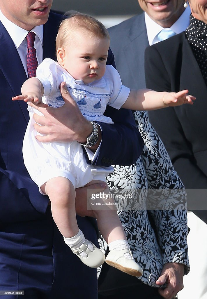 <a gi-track='captionPersonalityLinkClicked' href=/galleries/search?phrase=Prince+William&family=editorial&specificpeople=178205 ng-click='$event.stopPropagation()'>Prince William</a>, Duke of Cambridge carries <a gi-track='captionPersonalityLinkClicked' href=/galleries/search?phrase=Prince+George+of+Cambridge&family=editorial&specificpeople=11176510 ng-click='$event.stopPropagation()'>Prince George of Cambridge</a> as they arrive at Sydney Airport on a Australian Airforce 737 aircraft on April 16, 2014 in Sydney, Australia. The Duke and Duchess of Cambridge are on a three-week tour of Australia and New Zealand, the first official trip overseas with their son, <a gi-track='captionPersonalityLinkClicked' href=/galleries/search?phrase=Prince+George+of+Cambridge&family=editorial&specificpeople=11176510 ng-click='$event.stopPropagation()'>Prince George of Cambridge</a>.