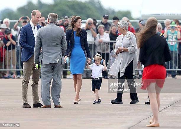 Prince William Duke of Cambridge Catherine Duchess of Cambridge and Prince George arrive for a visit to the Royal International Air Tattoo at RAF...