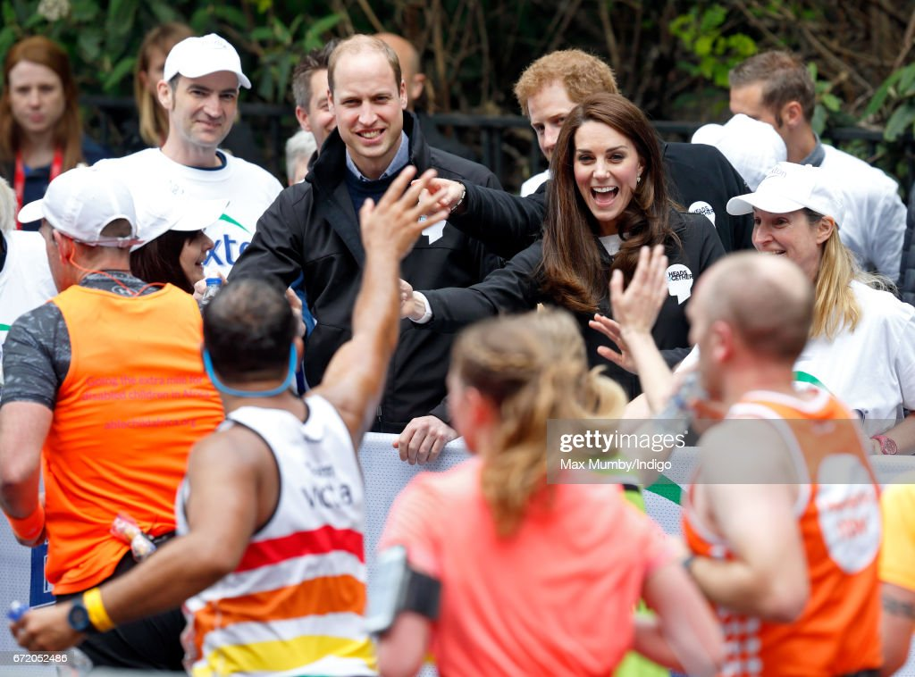 Prince William, Duke of Cambridge, Catherine, Duchess of Cambridge and Prince Harry hand out water to runners taking part in the 2017 Virgin Money London Marathon on April 23, 2017 in London, England. The Heads Together mental heath campaign, spearheaded by The Duke & Duchess of Cambridge and Prince Harry, is the marathon's 2017 Charity of the Year.