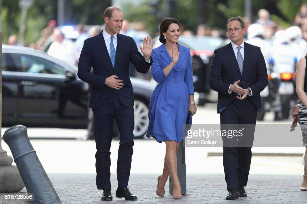 Prince William Duke of Cambridge Catherine Duchess of Cambridge and Berlin Mayor Michael Mueller arrive at the Brandenburg Gate during an official...