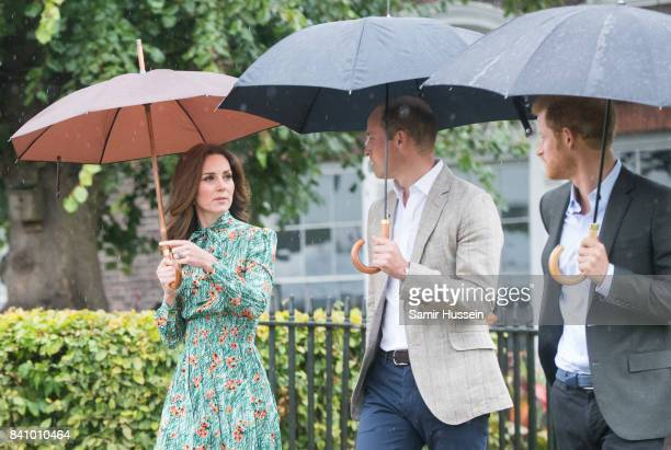 Prince William Duke of Cambridge Catherine Duchess of Cambridge and Prince Harry visit The Sunken Garden at Kensington Palace on August 30 2017 in...