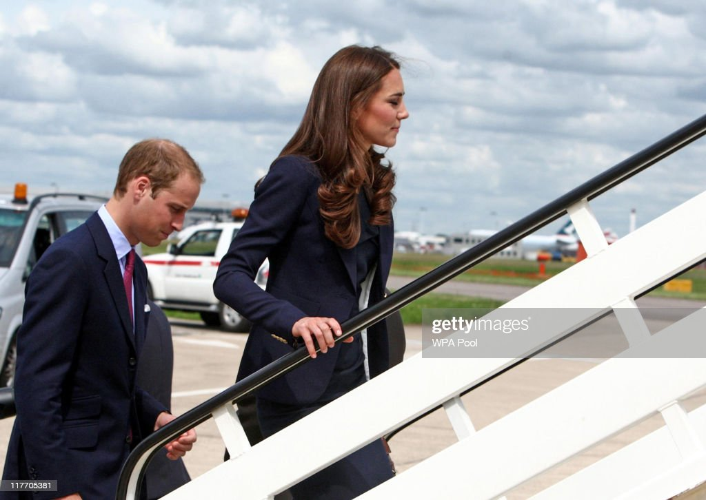 Prince William, Duke of Cambridge & Catherine, Duchess of Cambridge board a plane of the Royal Canadian Air Force at London's Heathrow Airport on June 30, 2011 in London, England. The Duke and Duchess of Cambridge travel to Ottawa for their first overseas tour as a married couple, the 11 day tour will take them to Canada and then on to California.