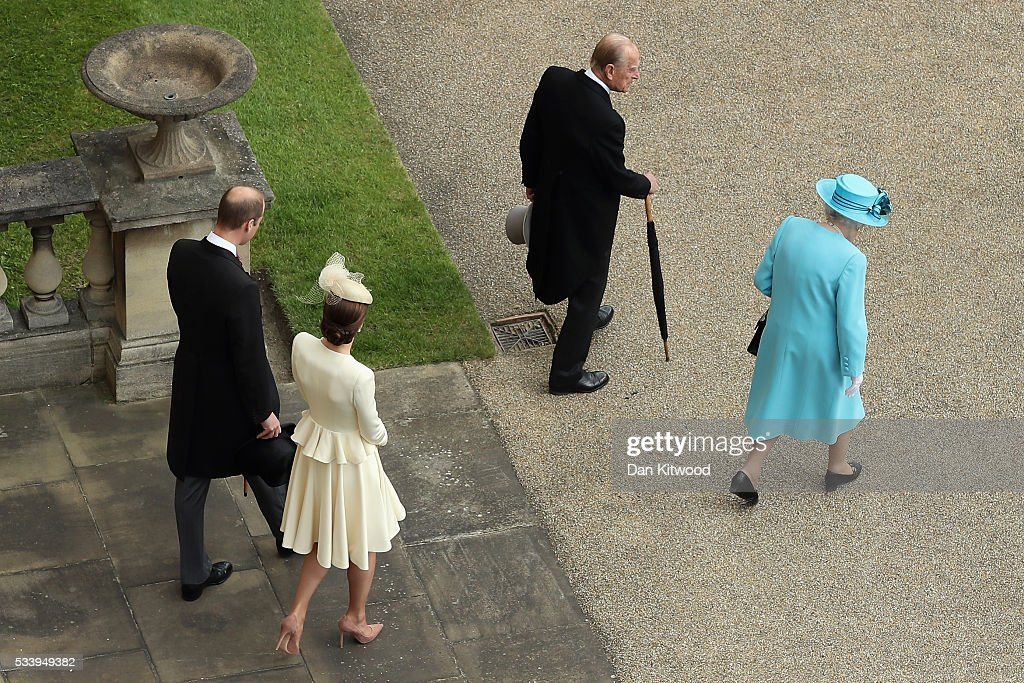 Prince William, Duke of Cambridge, Catherine, Duchess of Cambridge, Prince Philip, Duke of Edinburgh and Queen Elizabeth II arrive to greet guests attending a garden party at Buckingham Palace on May 24, 2016 in London, England.