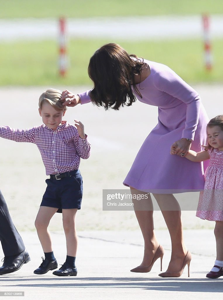 Prince William, Duke of Cambridge, Catherine, Duchess of Cambridge, Prince George of Cambridge and Princess Charlotte of Cambridge view helicopter models H145 and H135 before departing from Hamburg airport on the last day of their official visit to Poland and Germany on July 21, 2017 in Hamburg, Germany.