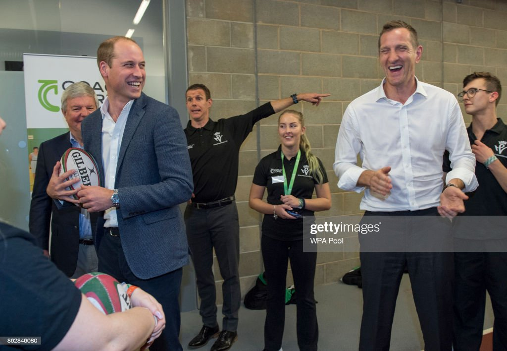 Prince William, Duke of Cambridge chats with Former England and British and Irish Lions centre Will Greenwood during the Coach Core graduation ceremony for more than 150 Coach Core apprentices at The London Stadium on October 18, 2017 in London, England.