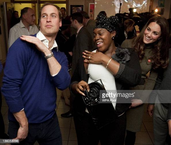 Prince William Duke of Cambridge dances with Vanessa Boateng as his wife Catherine Duchess of Cambridge looks on during a reception at Centrepoint's...