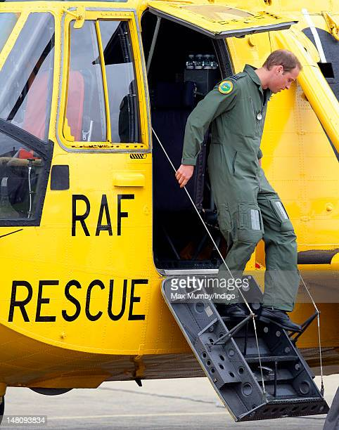 Prince William Duke of Cambridge disembarks his RAF Search and Rescue Sea King Helicopter after giving his father Prince Charles Prince of Wales a...