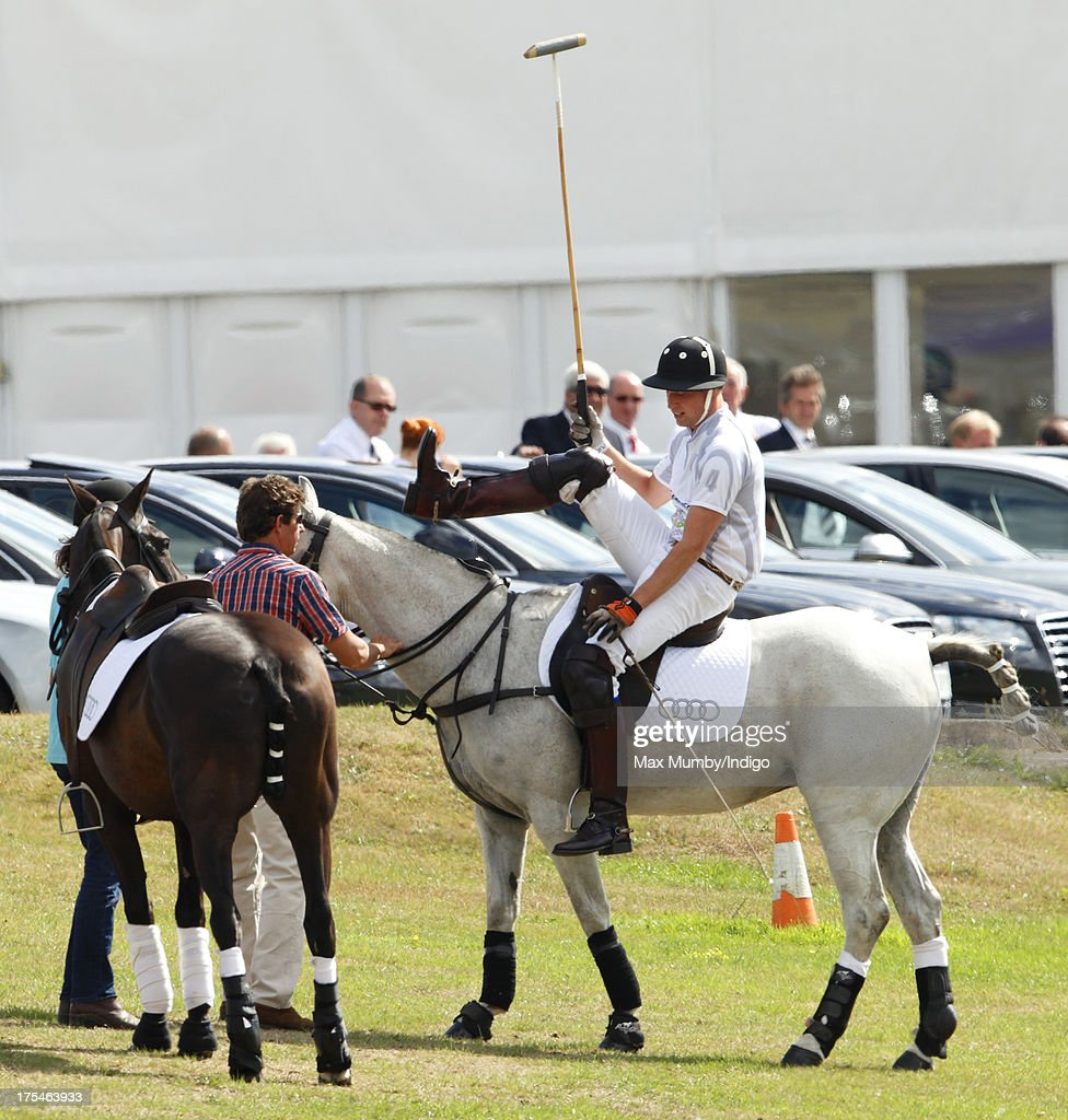 Prince William, Duke of Cambridge dismounts from his polo pony as he plays in the Audi Polo Challenge at Coworth Park Polo Club on August 3, 2013 in Ascot, England.