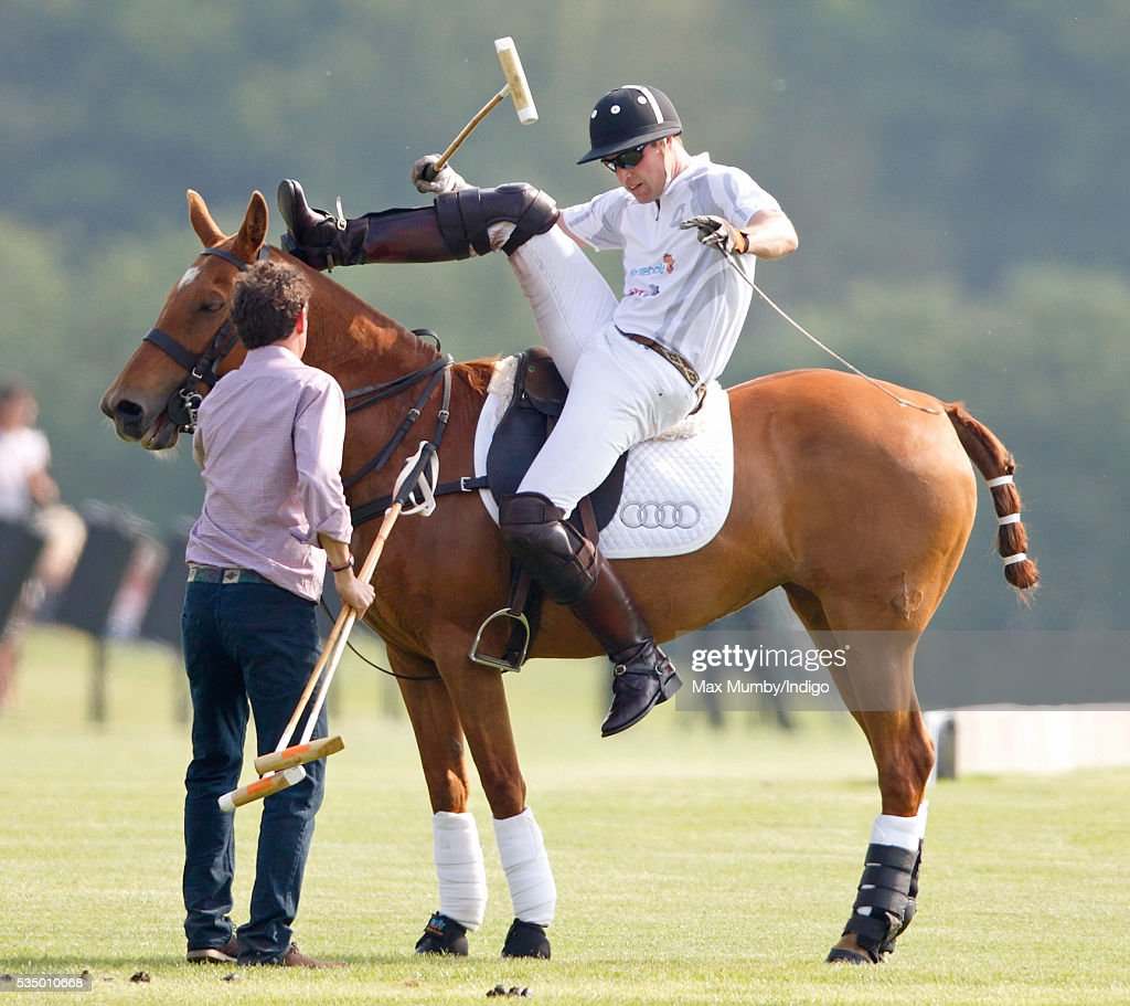 Prince William, Duke of Cambridge dismounts from his polo pony as he takes part in the Audi Polo Challenge at Coworth Park Polo Club on May 28, 2016 in Ascot, England.