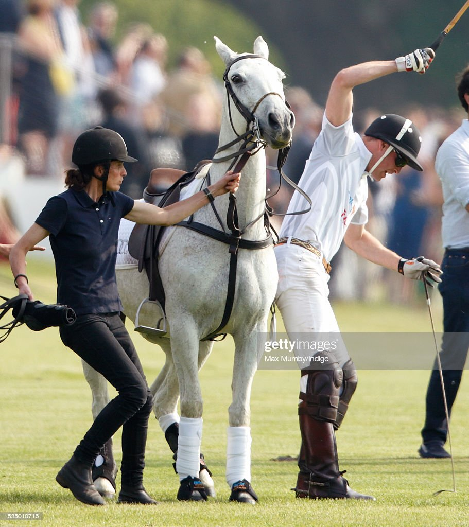 <a gi-track='captionPersonalityLinkClicked' href=/galleries/search?phrase=Prince+William&family=editorial&specificpeople=178205 ng-click='$event.stopPropagation()'>Prince William</a>, Duke of Cambridge dismounts from his polo pony as he takes part in the Audi Polo Challenge at Coworth Park Polo Club on May 28, 2016 in Ascot, England.