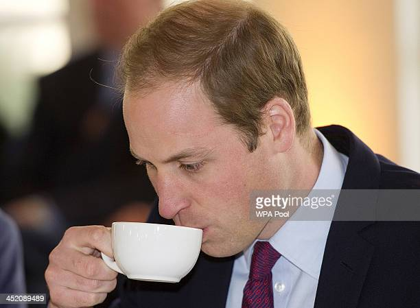 Prince William Duke of Cambridge drinks a cup of tea as he attends a meeting of 'United for Wildlife' at the Zoological Society of London on November...