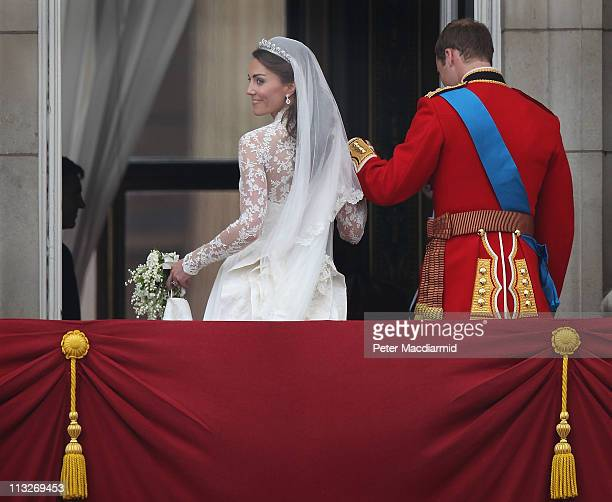 Prince William Duke of Cambridge escorts Catherine Duchess of Cambridge from the balcony at Buckingham Palace on April 29 2011 in London England The...