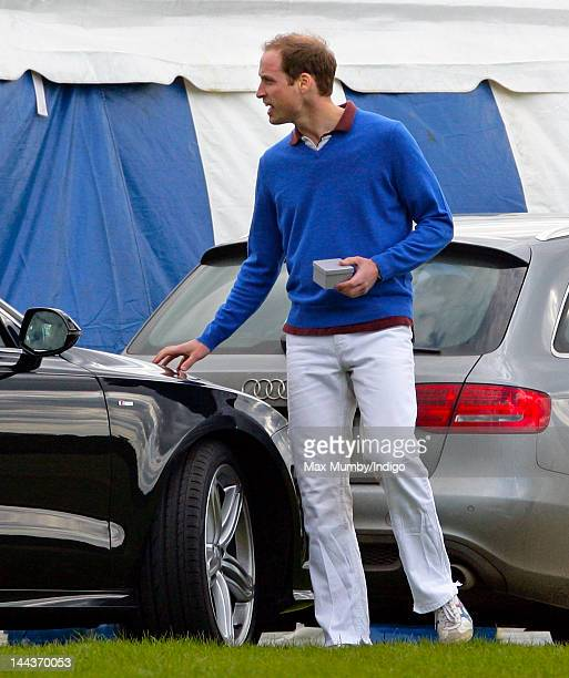 Prince William Duke of Cambridge gets into his Audi A7 car after playing along with Prince Harry in the Audi Polo Challenge charity polo match at...