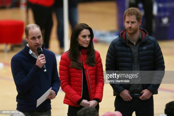 Prince William Duke of Cambridge gives a speech as Catherine Duchess of Cambridge and Prince Harry look on during a training day for the Heads...