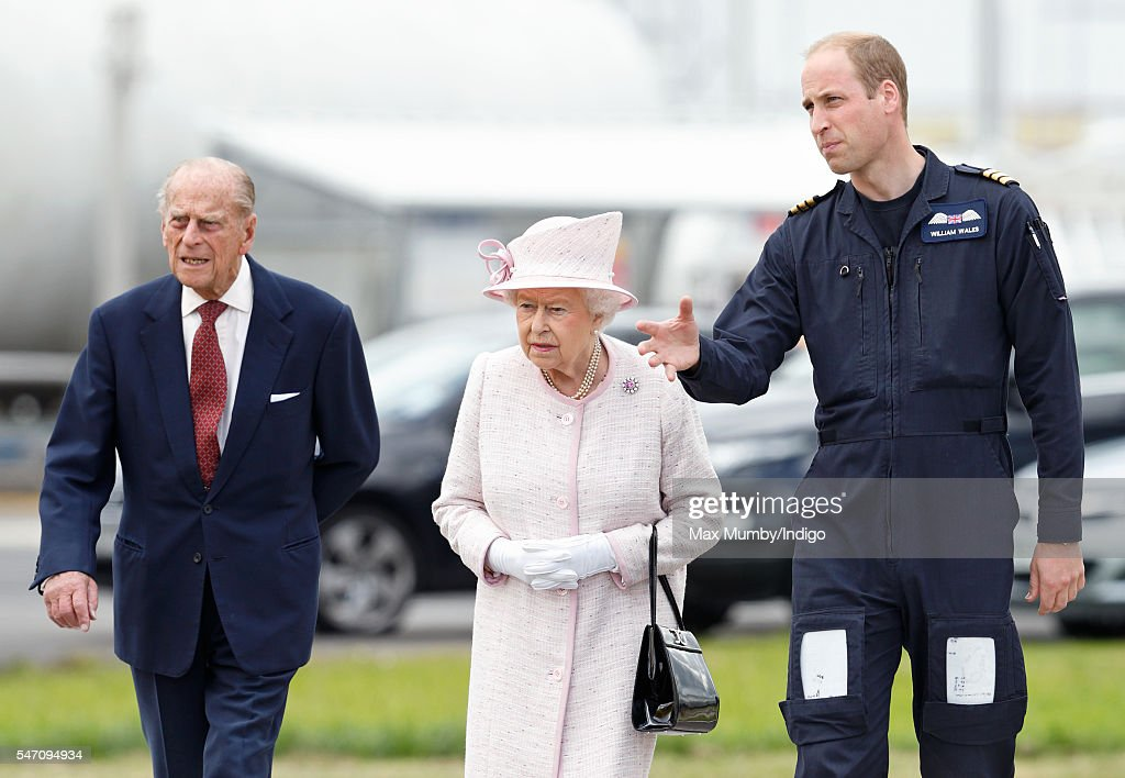 Prince William, Duke of Cambridge gives his grandparents Queen Elizabeth II and Prince Philip, Duke of Edinburgh a tour as they open the new East Anglian Air Ambulance base at Cambridge Airport on July 13, 2016 in Cambridge, England.