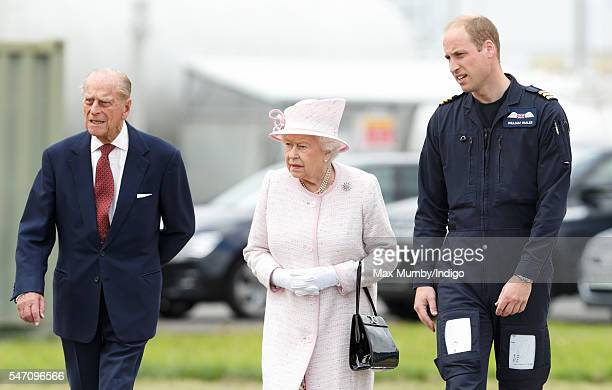 Prince William Duke of Cambridge gives his grandparents Queen Elizabeth II and Prince Philip Duke of Edinburgh a tour as they open the new East...