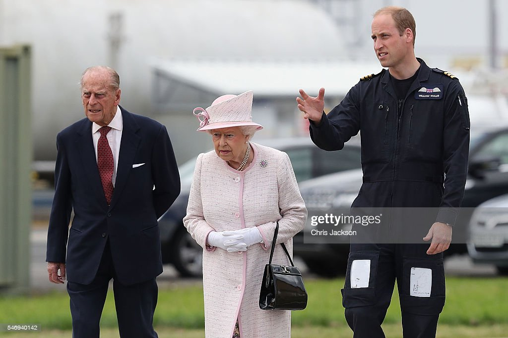 Prince William, Duke of Cambridge gives Queen Elizabeth II and Prince Philip, Duke of Edinburgh a tour as they open the new East Anglian Air Ambulance Base at Cambridge Airport on July 13, 2016 in Cambridge, England.