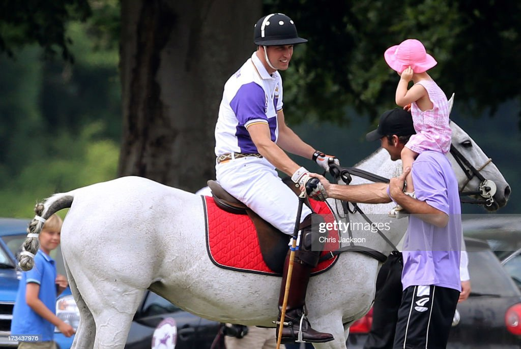 <a gi-track='captionPersonalityLinkClicked' href=/galleries/search?phrase=Prince+William&family=editorial&specificpeople=178205 ng-click='$event.stopPropagation()'>Prince William</a>, Duke of Cambridge greets a young girl during the Jerudong Trophy at Cirencester Park Polo Club on July 14, 2013 in Cirencester, England.
