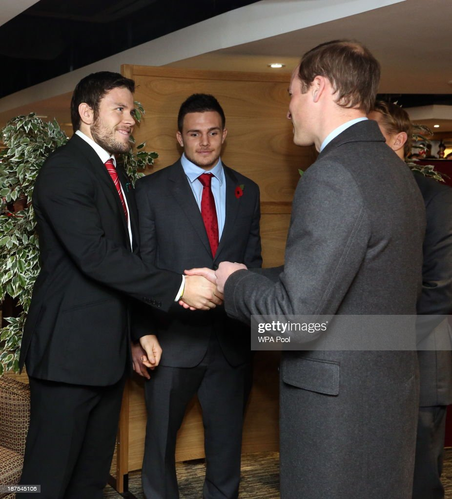 Prince William, Duke of Cambridge (R) greets Adam Thomas the Wales 7's captain in the International Player's Lounge after the Autumn International between Wales and South Africa at the Millennium Stadium on November 9, 2013 in Cardiff, Wales.