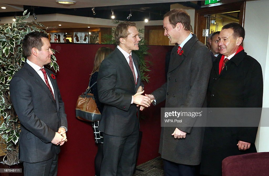 Prince William, Duke of Cambridge (2nd R) greets (L-R) Gethin Watts, WRU Head of Rugby Josh Lewsey and WRU chief executive Roger Lewis in the International Player's Lounge after the Autumn International between Wales and South Africa at the Millennium Stadium on November 9, 2013 in Cardiff, Wales.
