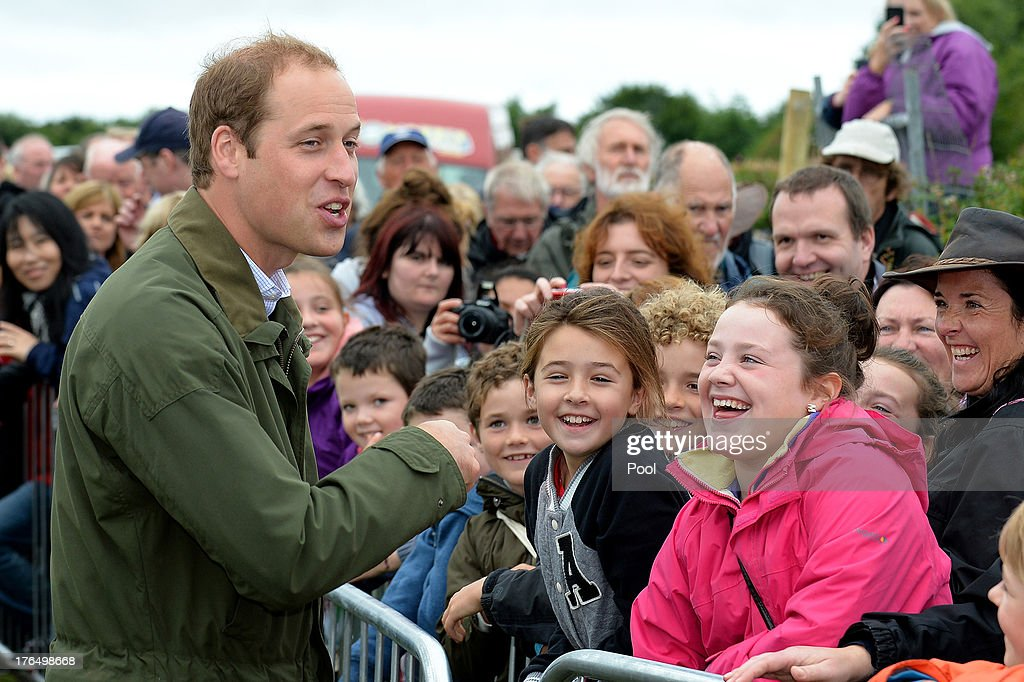 <a gi-track='captionPersonalityLinkClicked' href=/galleries/search?phrase=Prince+William&family=editorial&specificpeople=178205 ng-click='$event.stopPropagation()'>Prince William</a>, Duke of Cambridge greets the public during his visit at Anglesey agricultural show on his first official engagement since the birth of his son Prince George of Cambridge last month at Anglesey Showground on August 14, 2013 in Bangor, Wales. <a gi-track='captionPersonalityLinkClicked' href=/galleries/search?phrase=Prince+William&family=editorial&specificpeople=178205 ng-click='$event.stopPropagation()'>Prince William</a> had two weeks parental leave from work as a RAF rescue helicopter pilot in Anglesey.