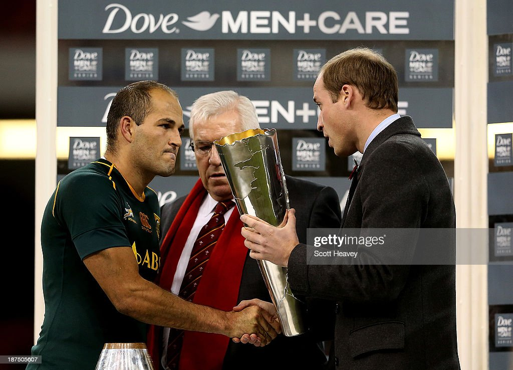 Prince William, Duke of Cambridge hands the trophy to Fourie Du Preez of South Africa during an International between Wales and South Africa at Millennium Stadium on November 9, 2013 in Cardiff, Wales.