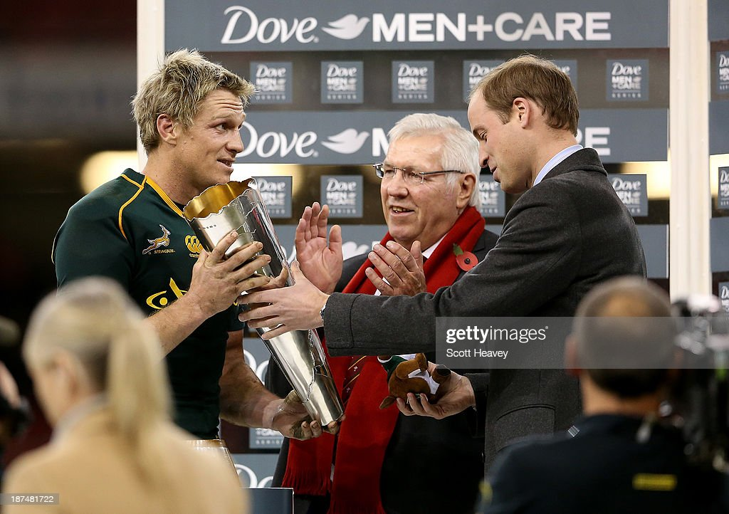 Prince William, Duke of Cambridge hands the trophy to Jean De Villiers of South Africa during an International between Wales and South Africa at Millennium Stadium on November 9, 2013 in Cardiff, Wales.