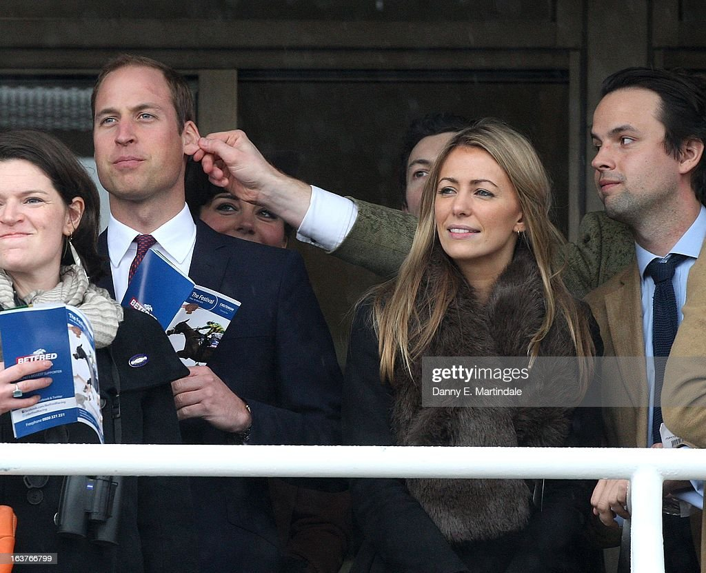 Prince William, Duke of Cambridge has his ear pulled by a friend as he watches the races during day 4 of the Cheltenham Festival at Cheltenham Racecourse on March 15, 2013 in Cheltenham, England.