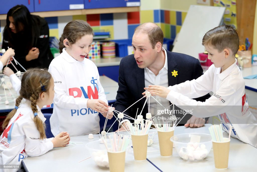 prince-william-duke-of-cambridge-helps-children-complete-a-task-as-picture-id646667514