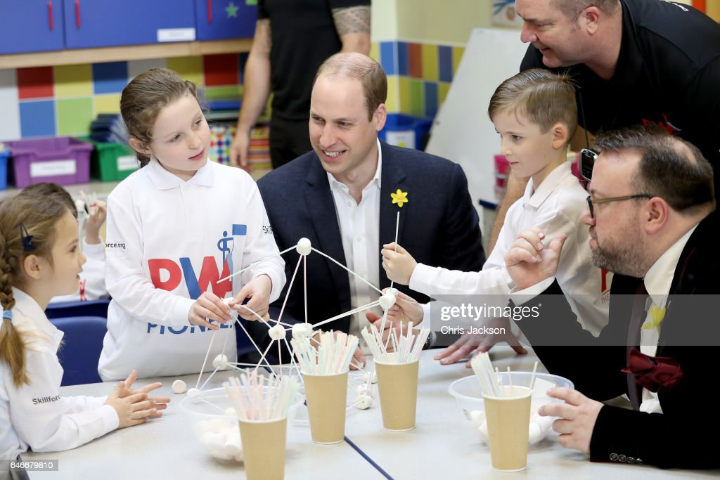 prince-william-duke-of-cambridge-helps-children-complete-a-task-as-picture-id646679810