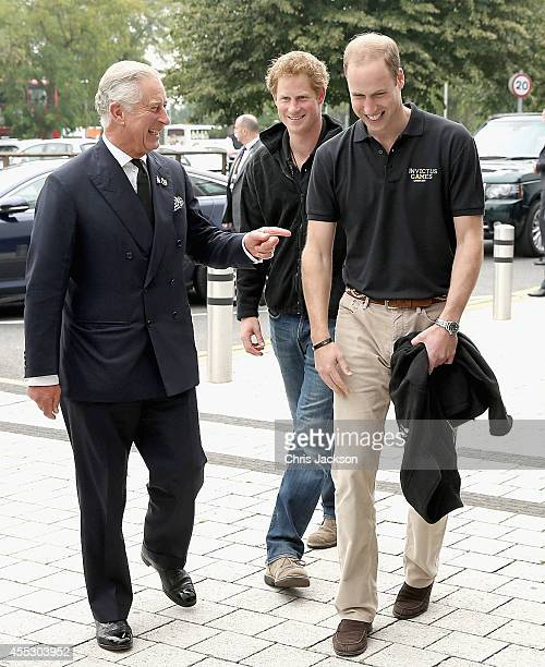 Prince William Duke of Cambridge his brother Prince Harry and their father Prince Charles Prince of Wales arrive for the athletes during the Invictus...