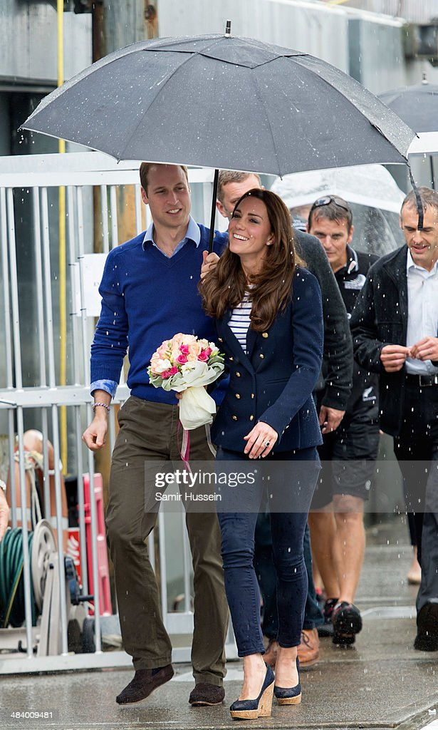 Prince William, Duke of Cambridge holds an umbrella up for Catherine, Duchess of Cambridge ahead of going sailing during their visit to Auckland Harbour on April 11, 2014 in Auckland, New Zealand. The Duke and Duchess of Cambridge are on a three-week tour of Australia and New Zealand, the first official trip overseas with their son, Prince George of Cambridge.
