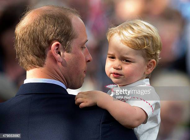 Prince William Duke of Cambridge holds Prince George of Cambridge as they leave the Church of St Mary Magdalene on the Sandringham Estate for the...